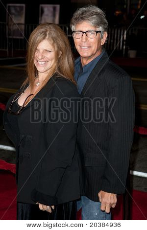HOLLYWOOD, CA. - DEC 7: Eric Roberts (R) and guest arrive at the Los Angeles premiere of The Fighter at Grauman's Chinese Theatre on Dec. 7, 2010 in Hollywood, California.