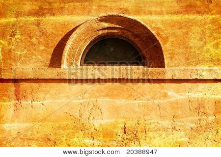 rustic grunge wall with an arched window