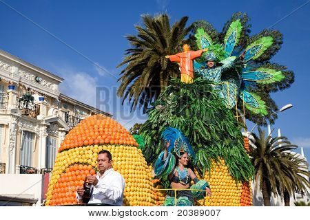 float with oranges and lemons and performers as part of festival in Menton, France
