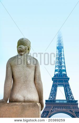 Statue of woman at the Trocadero overlooking Eiffel Tower winter time in Paris, France