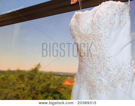 Ivory silk and chiffon wedding dress beaded with pearls ? view from the front