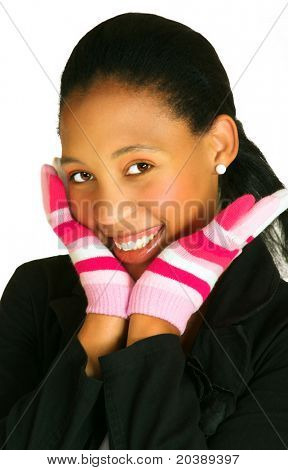 young african woman with a bright smile resting her face on hands in pink gloves