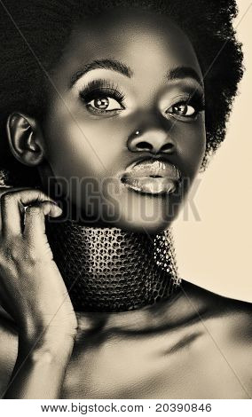 beautiful south African woman with bronze necklace, long false eyelashes, with lots of shine on her skin in platinum print effect, from 16Bit RAW