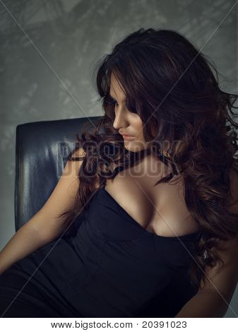 Beautiful brunette hispanic woman with smoky eye make-up and red lips