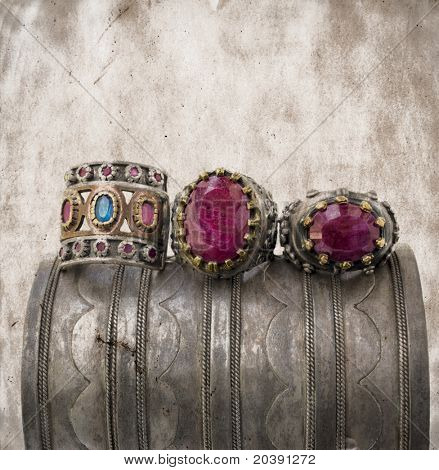 three ottoman style vintage rings on a grunge silver bracelet.