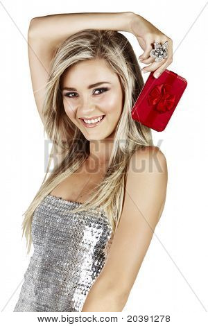 beautiful smiling blond woman in silver dress holding red gift box isoltaed on white