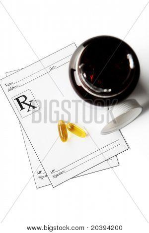 Prescription Medicine and Bottle on paper with RX symbol