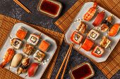 Sushi Set: Sushi And Sushi Rolls On Plate. poster