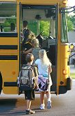 stock photo of driving school  - Group of Kids Getting on School Bus - JPG