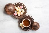 Traditional turkish coffee and turkish delight on white shabby wooden background.  Top view. poster