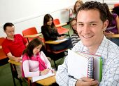 image of student teacher  - casual student or teacher in a classroom full of students - JPG