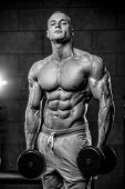 Brutal Caucasian Bodybuilder Training Shoulders In Gym.. poster