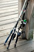 foto of fishing rod  - photographed fishing rods at local fishing pier on the coastline of Georgia - JPG