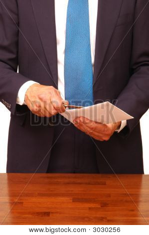Businessman Opening Envelope