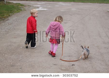 Kids walking the dog