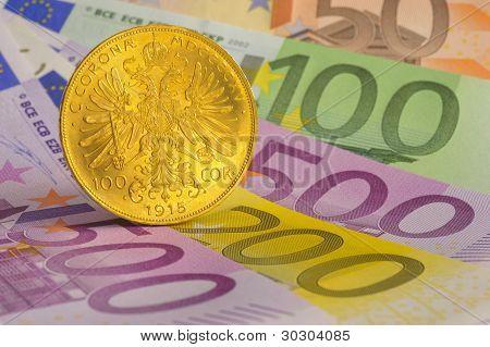 euro e a moeda de ouro