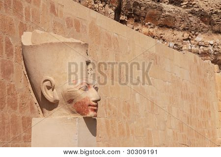 Face In Ancient Stone Column
