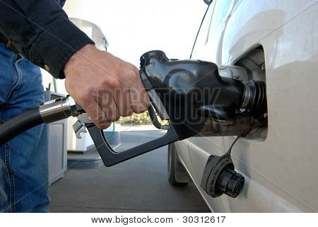 Close Up Of Man's Hand Filling Gas Tank