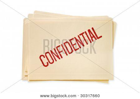 Pilha de manilla pastas, carimbadas de arquivos confidenciais.
