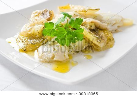 Fish with potatoes.