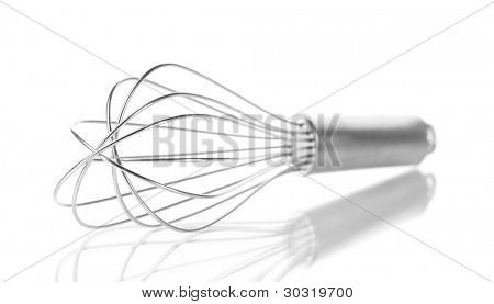 Metal whisk for whipping eggs isolated on white