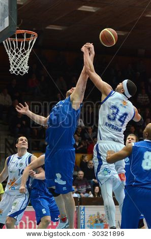 KAPOSVAR, HUNGARY â?? FEBRUARY 18: Michael Fey (white34) in action at a Hungarian Championship basketball game with Kaposvar (white) vs. Fehervar (blue) on February 18, 2012 in Kaposvar, Hungary.
