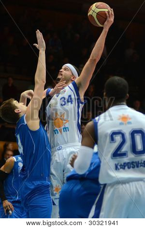 KAPOSVAR, HUNGARY – FEBRUARY 18: Michael Fey (white, 34) in action at a Hungarian Championship basketball game with Kaposvar (white) vs. Fehervar (blue) on February 18, 2012 in Kaposvar, Hungary.