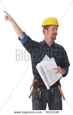 Construction Worker Pointing On Architectural Plans