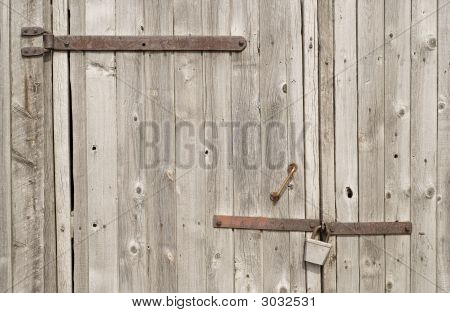 Lock And Wooden Gate