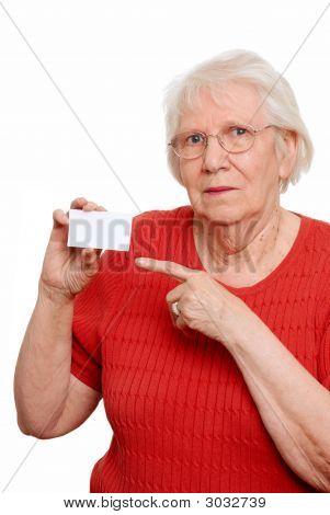 Elderly Woman Pointing To A Business Card