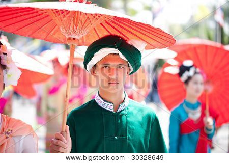 CHIANG MAI, THAILAND - FEBRUARY 4: An unidentified traditionally dressed man participates in the Chiang Mai 36th Flower Festival procession on February 4, 2012 in Chiang Mai, Thailand