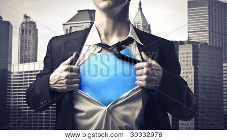 Closeup of a businessman showing the superhero suit under his shirt