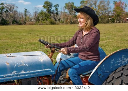 Mature Beauty Driving Tractor