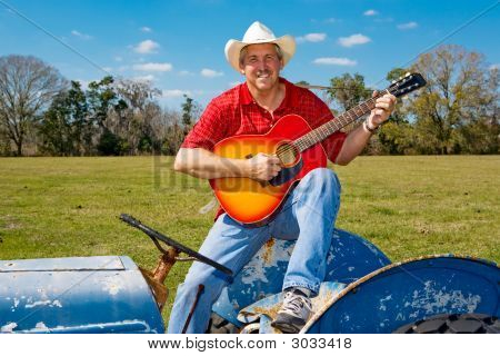 Singing Cowboy Strums Guitar