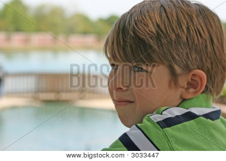 Young boy at the park. Bridge crossing
