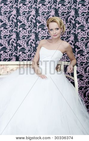 Bride Sitting With Slight Smirking
