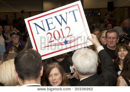 Newt holds part of a supporters sign.