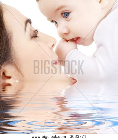 Happy Mother Playing With Baby Boy In Water #2