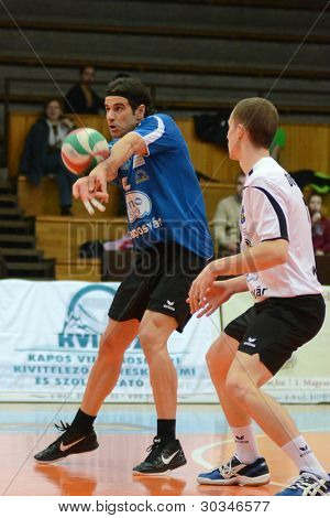 KAPOSVAR, HUNGARY - FEBRUARY 23: Andras Geiger (L) in action at a Hungarian volleyball National Championship game Kaposvar (blue) vs. Csepel ( deep blue), on February 23, 2012 in Kaposvar, Hungary.