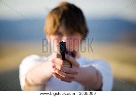 Teenager Pointing Handgun At Camera