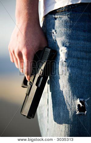 Teen With Handgun