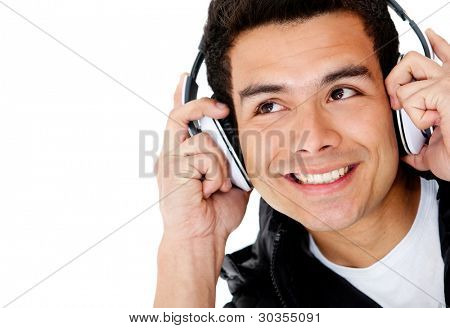 Man portrait with headphones listening to music - isolated over a white background