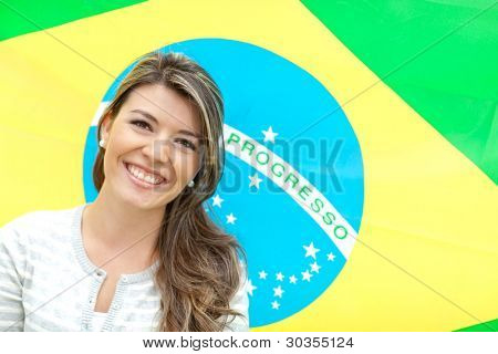Beautiful young woman with the flag of Brazil