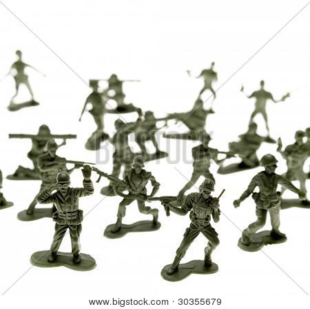 Toy soldiers on plain background