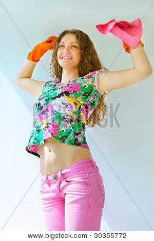 Attractive girl washing the window with mop