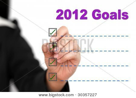 Asian business woman writing 2012 Goal List
