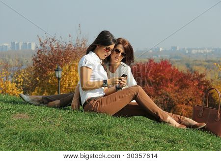 women with autumn maple leaves in park at fall outdoors