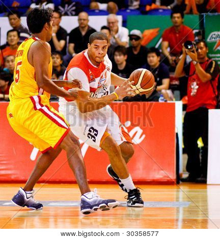 KUALA LUMPUR - FEBRUARY 19: Malaysian Dragons' Brian Williams (33) dribbles in against the Singapore Slingers at the ASEAN Basketball League match on Feb 19, 2012 in Kuala Lumpur, Malaysia. Dragons won 86-71.