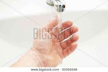 Washing Of Hands Under The Crane With Water