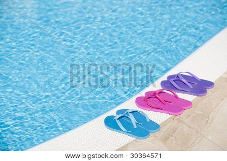 Colorful slippers by pool